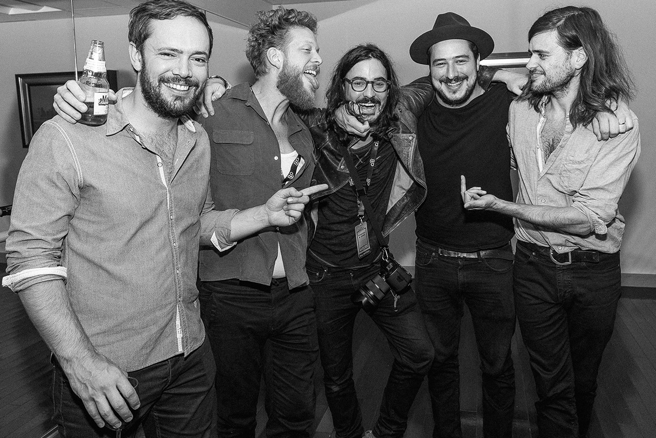 Ty Johnson and Mumford & Sons shot backstage in New York City